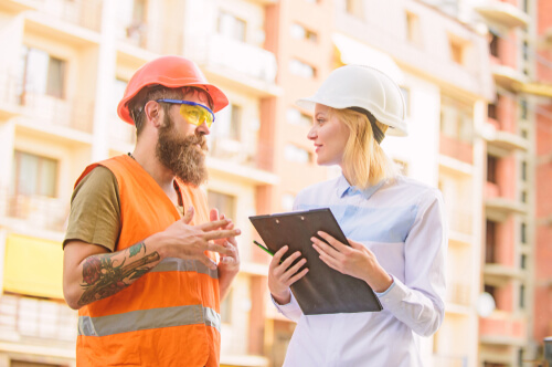 two builders discussing business