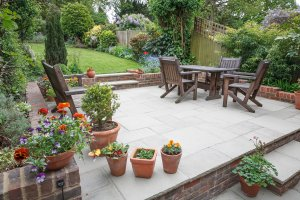 Hard,Landscaping,,New,Luxury,Stone,Patio,And,Garden,Of,An